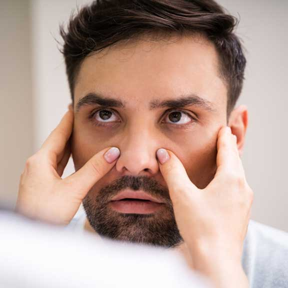 Physician Doctor Doing Sinusitis Examination For Sinus Inflammation